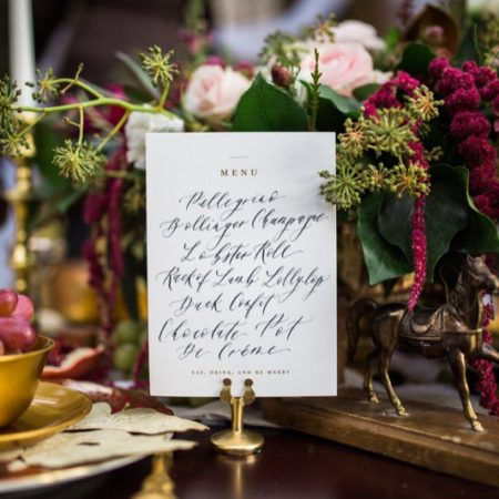 Event photo - menu with florals and table settings